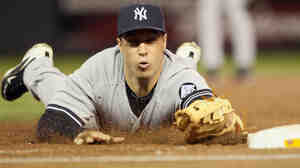 Mark Teixeira of the New York Yankees tags first base to get an out against the Minnesota Twins in last year's American League Division Series.