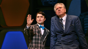 Finch ingratiates himself with his new boss, J.B. Biggley (John Larroquette, right), by claiming they went to the same school.