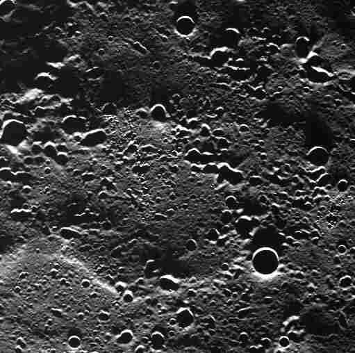 A never-before-imaged area of Mercury's surface is seen from an altitude of 280 miles above the planet during the Messenger's first orbit with the camera in operation. The area is covered in secondary craters made by an impact outside of the field of view. Some of the secondary craters are oriented in chain-like formations.