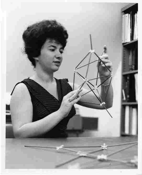 "Joyce Jacobson KaufmanSmithsonian writes: ""American chemist Joyce Jacobson Kaufman, shown holding a molecular model ... in July 1964. ... She is noted for carrying out the first all-valence-electron, three-dimensional quantum-chemical calculations, and for research on the clinical effects of tranquilizers and narcotic drugs."