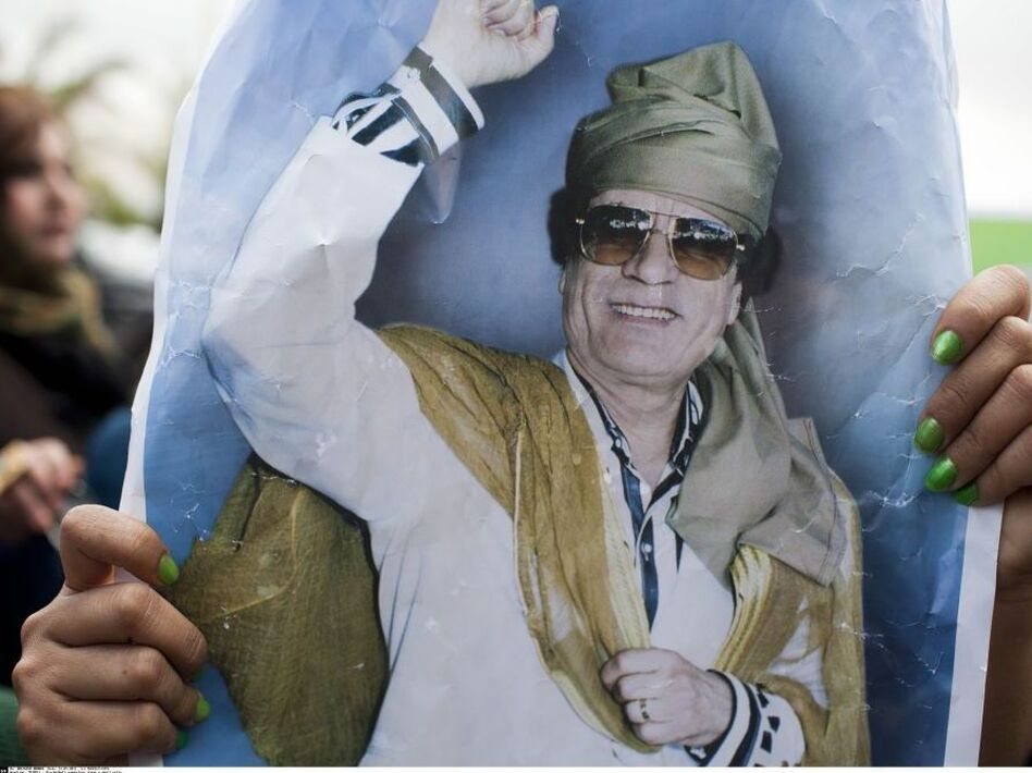 Supporters of Libyan leader Moammar Gadhafi stage a small rally in front the hotel where foreign journalists stay in Tripoli. (Facelly/SIPA/AP)