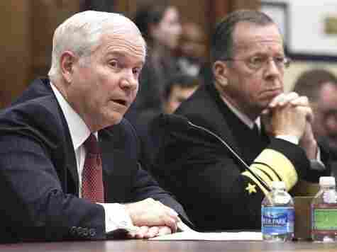 Defense Secretary Robert Gates, left, with Joint Chiefs Chairman Adm. Mike Mullen, on Capitol Hill on Thursday, March 31.