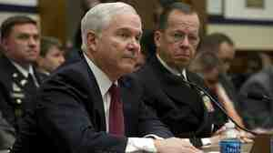 Secretary of Defense Robert Gates (left) and Chairman of the Joint Chiefs  of Staff Admiral Mike Mullen testify before the House Armed Services  Committee on Thursday about Operation Odyssey Dawn.