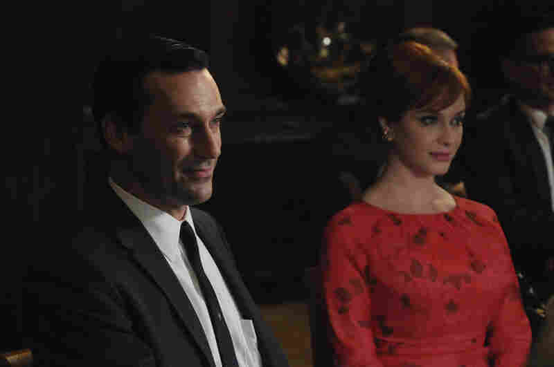 Jon Hamm as Don Draper, Christina Hendricks as Joan Harris