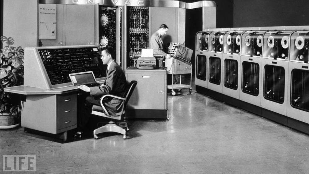 Two men operate the enormous UNIVAC (UNIVersal Automatic Computer) in 1960. With the arrival of UNIVAC, which first rolled out in 1951, computers were no longer reserved for the use of governments alone and became available to businesses.