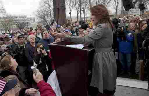 """Rep. Michele Bachmann (R-MN)  addresses a Tea Party """"Continuing Revolution Rally"""" on Capitol Hill, Thursday, March 31, 2011."""