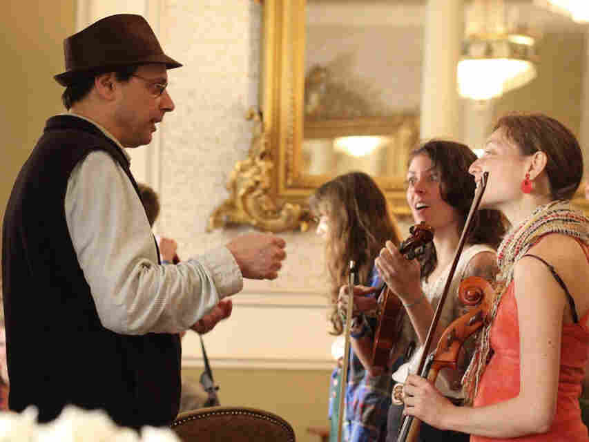 All Songs Considered host Bob Boilen chats with some members of Portland group Typhoon before their Tiny SXSW Concert at The Driskill Hotel.