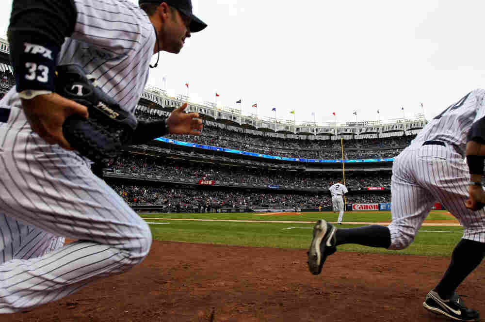 In the Bronx, Yankees (left to right) Nick Swisher, Derek Jeter and Curtis Granderson took the field earlier this afternoon for their game against the Detroit Tigers.