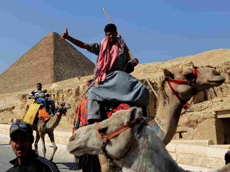 Camel owners wait for customers on the outskirts of Cairo on March 3. Tourism continues to suffer in Egypt following the uprising that forced President Hosni Mubarak to resign.