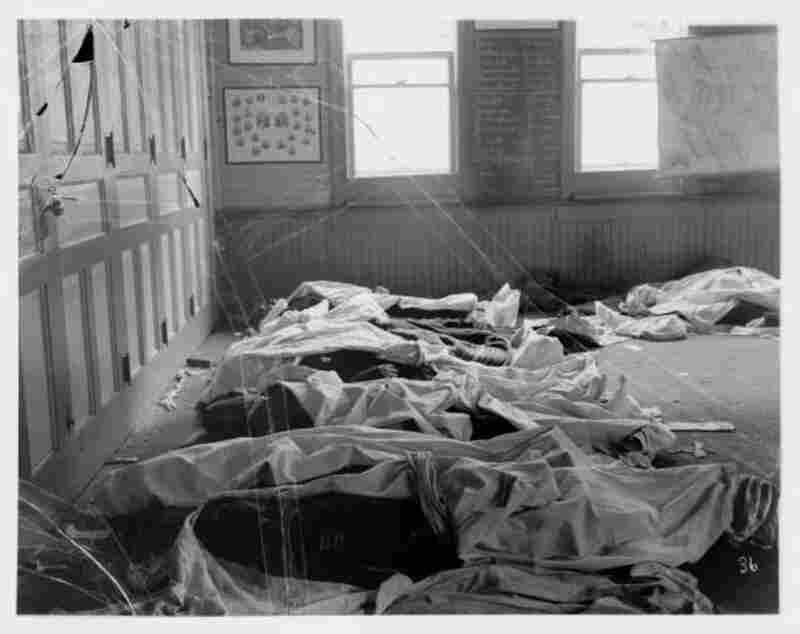 Covered Bodies in Schoolroom after 1900 Scofield Mine DisasterNote: On May 1, 1900, there was an explosion at a coal mine in Scofield. For the next two days, the people of Scofield and nearby Clear Creek tended to the dead and wounded as best as they could. Anderson made an extensive photographic record of the event.