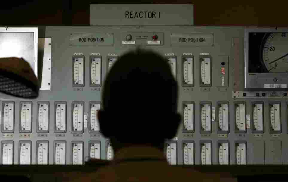 A power station worker monitors one of the reactors in the control room of England's Oldbury Nuclear Power Station in 2006.