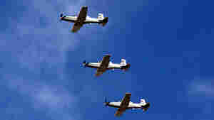 T-6 planes for pilot training fly over the Iraqi Air Force academy during its reopening ceremony north of Tikrit in December 2009.