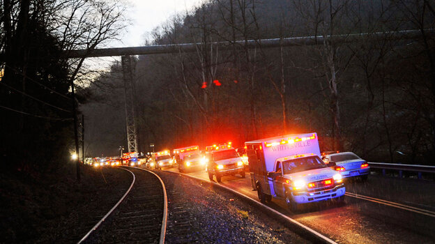 Emergency vehicles leave the entrance to Massey Energy's Upper Big Branch coal mine in Montcoal, W.Va., on April 5, 2010, after a deadly explosion.