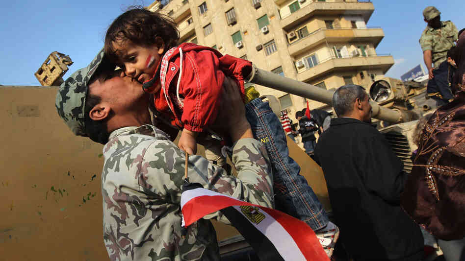 An Egyptian army soldier kisses a child in Tahrir Square in Cairo on Feb. 12, the day after President Hosni Mubarak resigned.