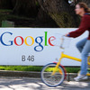 MOUNTAIN VIEW, CA - MARCH 10:  A bicyclist rides by a sign at the Google headquarters March 10, 2010 in Mountain View, California. Google announced today that they are adding bicycle routes to their popular Google Maps and is available in 150 U.S. cities. (Photo by Justin Sullivan/Getty Images)
