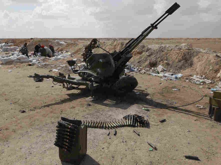 Libyan rebels rested today (April 1, 2011) next to an anti aircraft gun that near Ajdabiya, Libya.