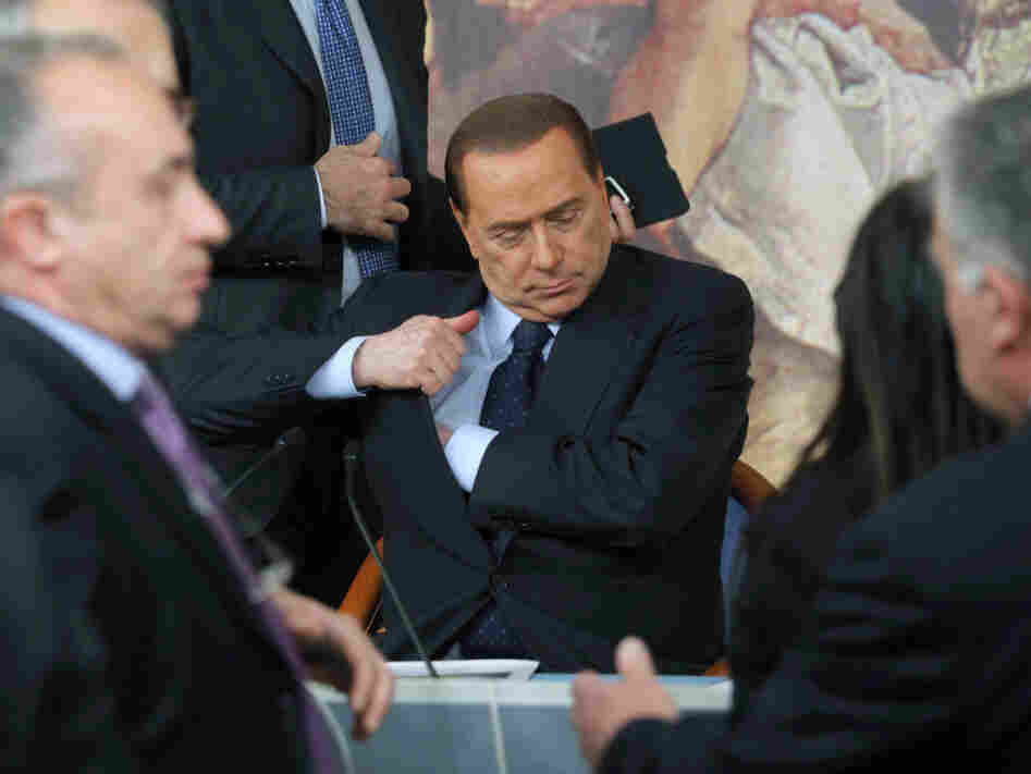 Italian leader Silvio Berlusconi discussed his government's handling of the migrant situation in Lampedusa Friday. Italy has shipped more than 2,000 migrants to detention camps on its mainland from the tiny clear-watered fishing and tourist island of Lampedusa.