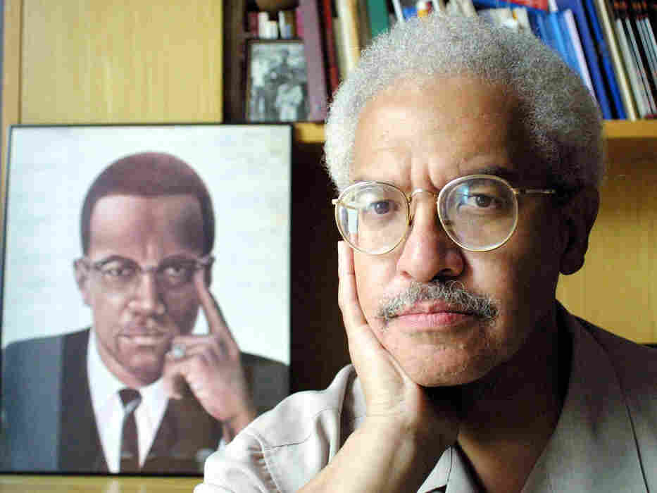 In his career, Manning Marable wrote about the struggle for equal rights — and especially the life of Malcolm X. In this file photo from 2001, he posed at his Columbia University office in New York.