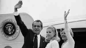 Richard Nixon, daughter Tricia and wife, Pat, board Air Force One after his resignation, Aug. 9, 1974.
