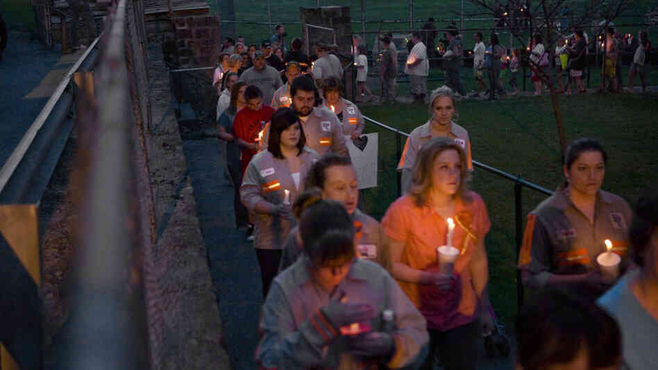 Community members, friends and family participate in a vigil held for the victims of the Upper Big Branch mine in front of the Whitesville Elementary School on April 7, 2010.
