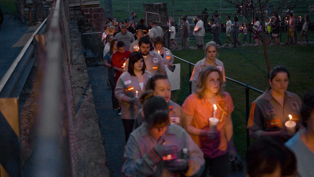 Community members, friends and family participate in a vigil held for the victims of the Upper Big Branch mine in front of the Whitesville Elementary School on April 7, 2010. (Getty Images)