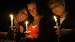 Relatives of Dean Jones, one of the 29 miners killed in the April 5 explosion of the Upper Big Branch mine, gathered for a vigil on April 10 with other families of the blast victims. From left are Julie Jones, Cassie Jones and Susan England.