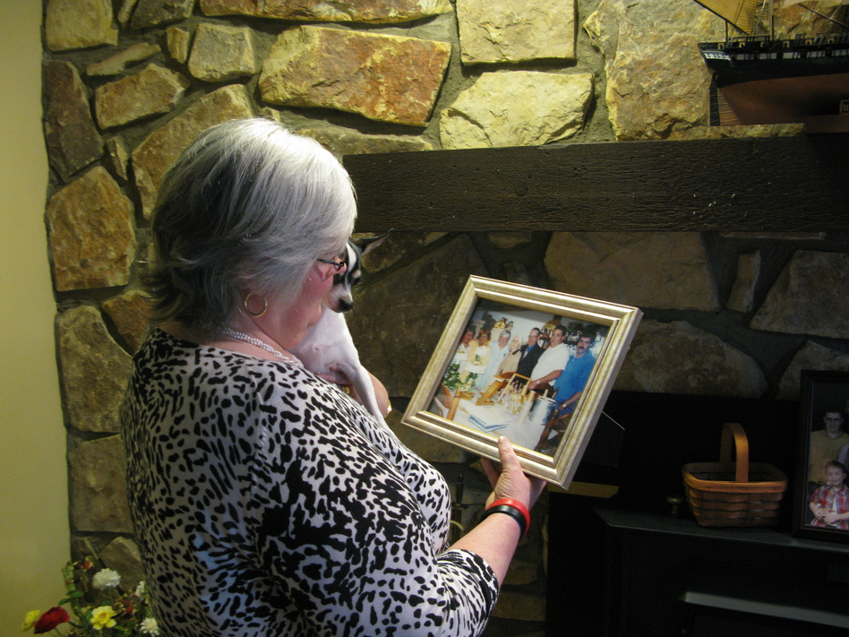 Judy Jones Petersen with a treasured photo of her family. After the Upper Big Branch mine blast, she had to wait four days to learn the fate of her brother. (NPR)