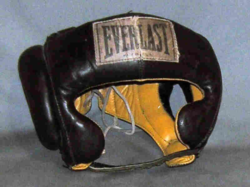 """Cassius Clay's (Muhammad Ali's) Head ProtectorThis is an Everlast head protector from the 5th Street Gym in Miami, where Clay trained for his first fight with Sonny Liston. """"As soon as he defeated Sonny Liston, he announced that he became a member of the Nation of Islam, became Muhammad Ali,"""" Bunch says."""
