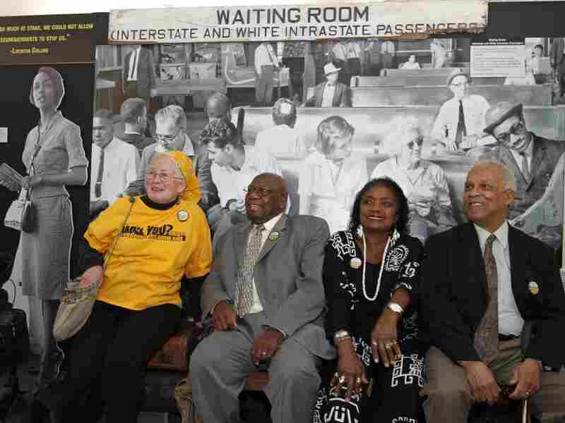 From left to right, Freedom Riders Joan Mulholland, Charles Person, Catherine Burks-Brooks and Reginald Green pose in front of a student-created exhibit on display at the University of Mary Washington in Fredericksburg, Va.