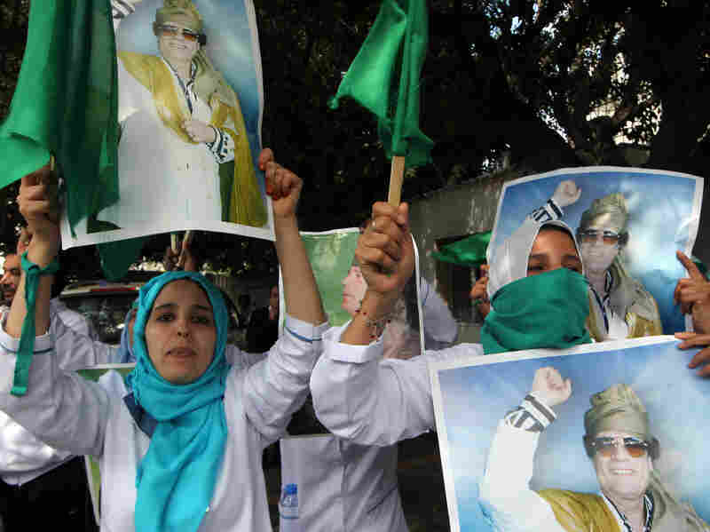 Supporters of Libyan leader Moammer Gadhafi protest outside U.N. offices in Tripoli on Saturday.
