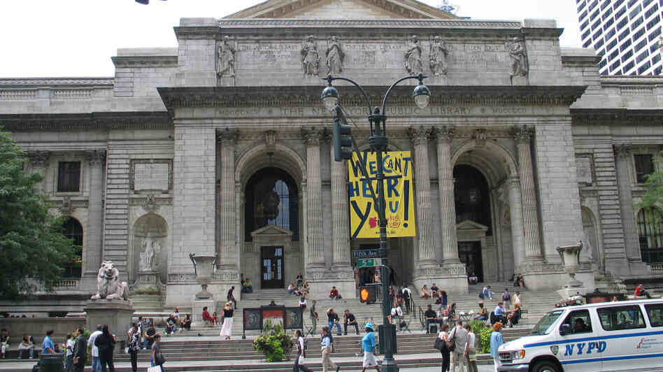 Pedestrians walk past the main building of the New York Public Library. But will they be going in to check out books in the future?