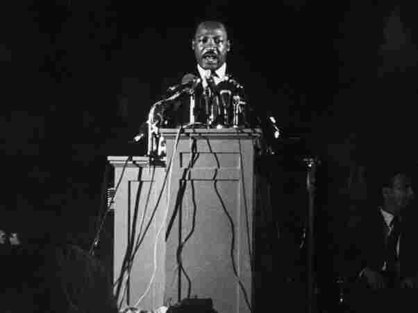 Martin Luther King addresses 2,000 supporters of a sanitary workers' strike at Memphis during his last speech Apr. 4, 1968 night.