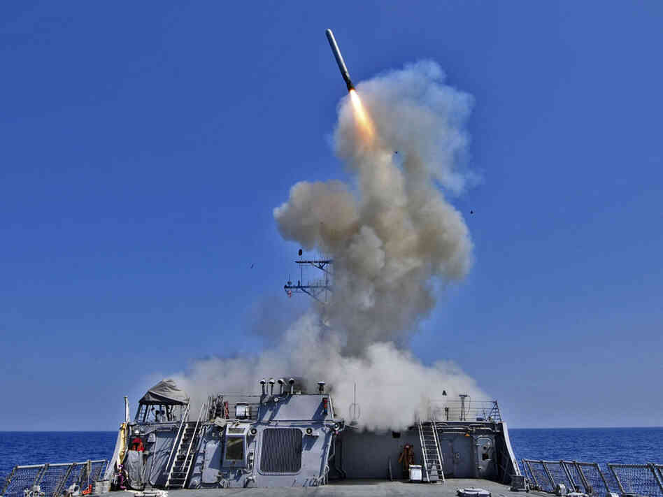 The Arleigh  Burke-class guided-missile destroyer USS Barry launches a Tomahawk  cruise missile from the ships bow, off the Libyan coast on March 29.