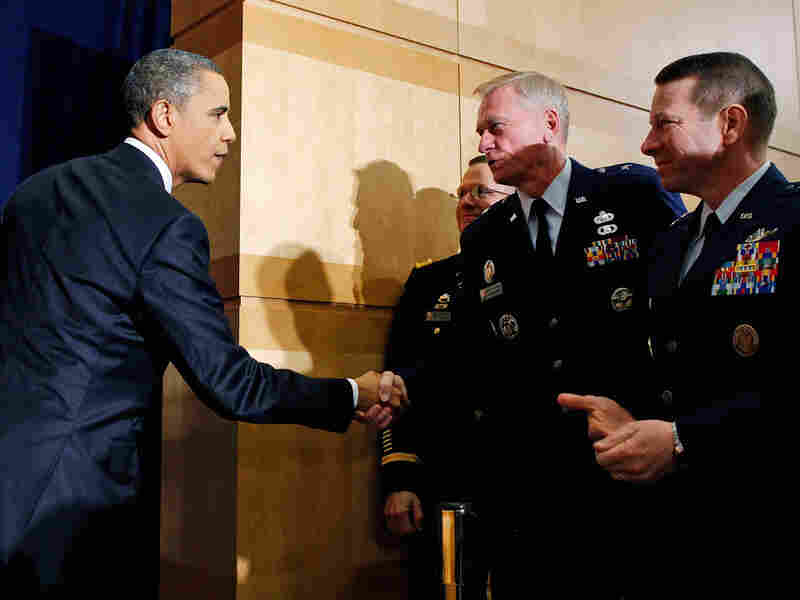 President Barack Obama shakes hands with military officers after speaking about Libya at the National Defense University in Washington on March 28.