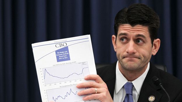 At a House Budget Committee hearing in February, Rep. Paul Ryan (R-WI) holds up a Congressional Budget Office report on the federal budget. (Getty Images)