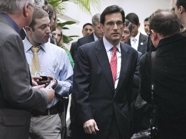 House Majority Leader Rep. Eric Cantor walks to a news conference, A