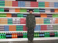 Liu Bolin prepares for his piece Supermarket No.2.