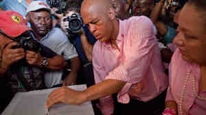 Then-candidate Michel Martelly casts his ballot at a polling station during a presidential runoff in Port-au-Prince, on March 20.