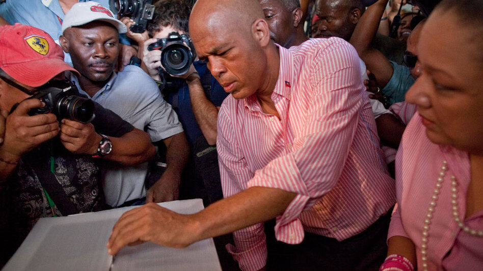 Then-candidate Michel Martelly casts his ballot at a polling station during a presidential runoff in Port-au-Prince, on March 20. (AP)