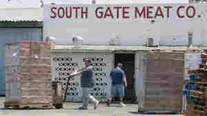 Workers move packages of meat at the South Gate Meat Company last June, when the Southern California meat distributor recalled 35,000 pounds of ground beef due to possible bacterial contamination.