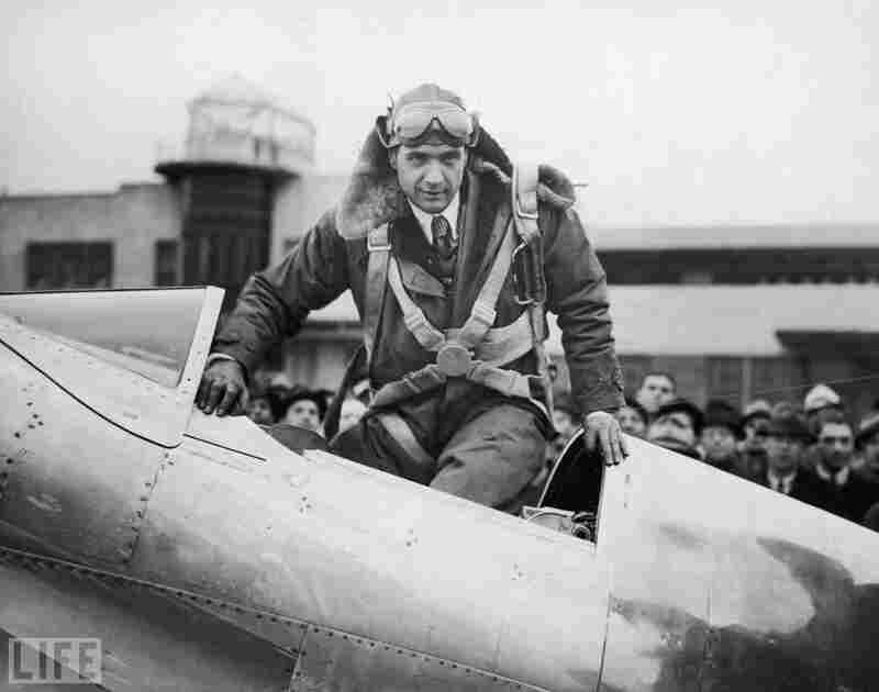 Hughes climbs into the cockpit of his Northrop Gamma H-1 plane (refitted with an engine he helped redesign and retool) in 1937, prior to breaking the speed record for transcontinental flight.
