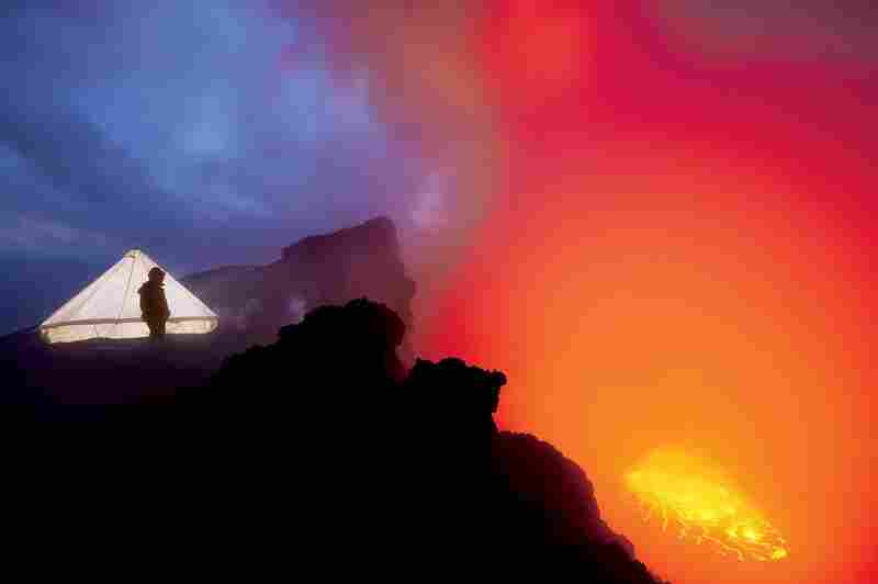 """The Nyiragongo expedition's cooking tent glows in the twilight on the rim of the volcano."""