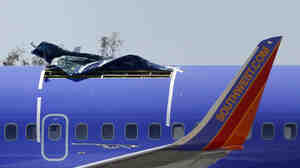 This Southwest Airlines jet was forced to make an emergency landing after part of the fuselage ruptured on Friday. The hole was in the top of the plane, above a wing.