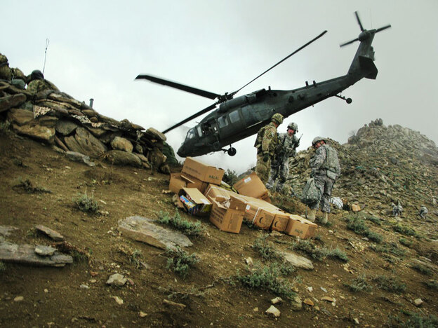 A  helicopter takes off March 28 after a risky landing on a mountain ridge in Laghman  province,  where it dropped off boxes of food and water for the JTAC team.