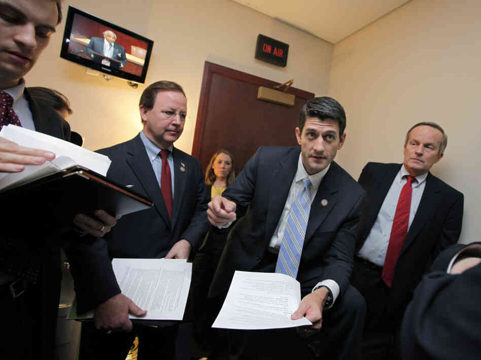The CBO says House Budget Committee Chairman Paul Ryan's plan for Medicare could lead to health care rationing. Ryan is shown here with Republican members of his comm
