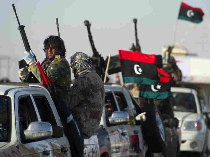 A convoy of rebel fighters leave for the frontline from the town of Ajdabiya on Tuesday. As fighting between opposition and pro-Gadhafi forces wages on, some are wondering what the next move is for the U.S. military.