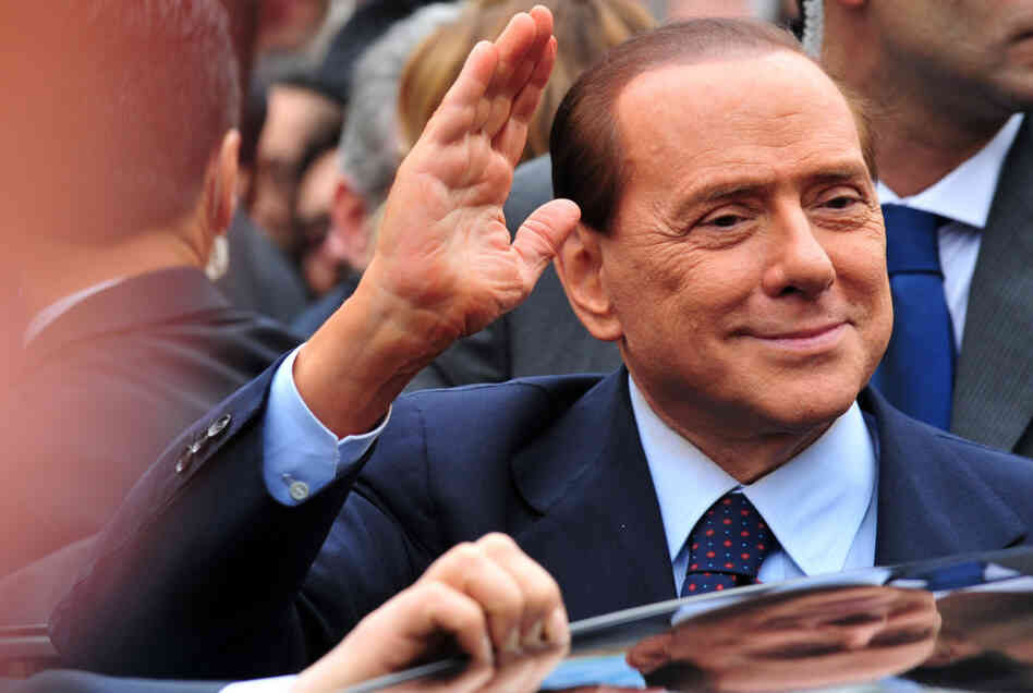 Italian Prime Minister Silvio Berlusconi acknowledges his supporters after a legal hearing on March 28.