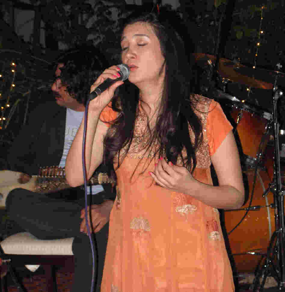 Zeb Bangash sings at a performance  coordinated by the U.S. Embassy. The two musicians are competing to tour the  United  States, part of a State Department cultural  exchange. The U.S. has spent  millions on public diplomacy in Pakistan.