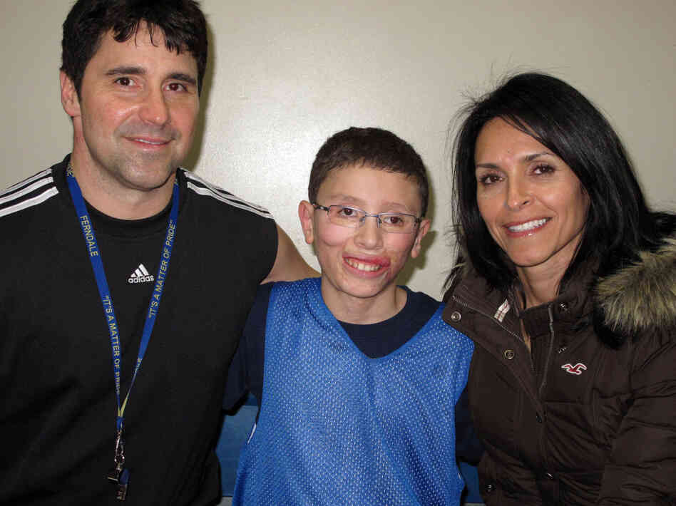Jake Finkbonner, shown with his father, Donny, and mother, Elsa, nearly died after contracting a flesh-eating bacterium. His family and friends prayed for a miracle, and now the Vatican is investigating whether one actually occurred.