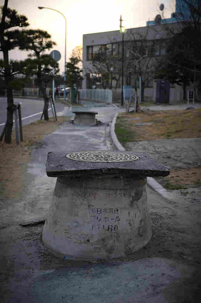 Manholes  poke out from the ground in Urayasu, Japan, due to the liquefaction triggered by the 9.0 magnitude earthquake. The phenomenon, which allows sand and water to rise following ground shaking, was particularly pronounced in this area as a result of the long duration of the March 11 quake.